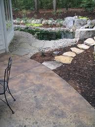 Backyard Cement Patio Ideas by Poured Concrete Patio With Rock Salt Finish Acid Stain 3 Color