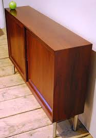 98209 a shallow mid century rosewood credenza circa 1960 sold