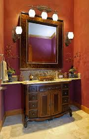 bathroom brown carved wooden bathromm cabinet with vessel sink on