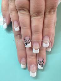 white french polish with black rosary bead nail art with swarovski
