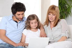 Parents Helping Their Child With Her Homework Stock Photo  Picture     Parents helping their child with her homework Stock Photo
