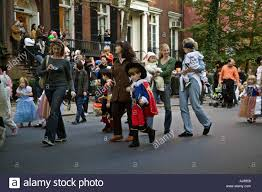 parents and kids march in the annual children u0027s halloween parade
