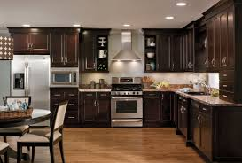 hickory wood nutmeg prestige door kitchens with espresso cabinets