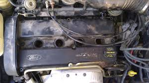 2004 ford focus engine cover would not budge after all screws are