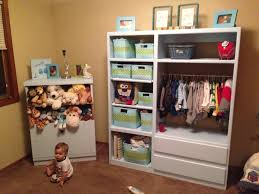 my entertainment center turned baby closet storage love the