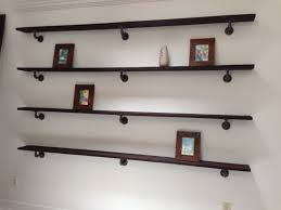 custom barn wood shelves with urban rustic plumbing pipe i think