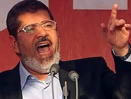 مجلة أمريكية: مرسي يخوض مذبحة