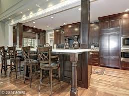 traditional kitchen with kitchen island u0026 glass panel in potomac