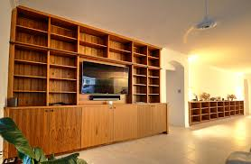 custom teak entertainment center with bookshelves majestic