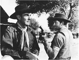 Randolph Scott (left) in