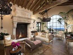 Exposed Beam Ceiling Living Room by Mediterranean Living Room With Stone Fireplace U0026 Exposed Beam In