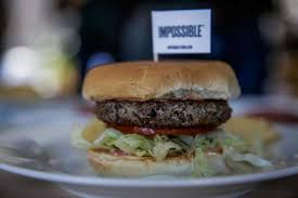 A non meat burger made by Impossible Foods rests on a plate before being tasted San Francisco Chronicle