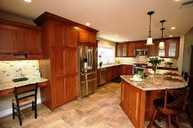 contemporary kitchen with cherry cabinets and island traditional