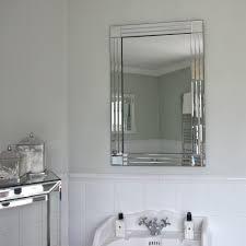 art deco bathroom mirror glam bathroom features gray walls lined