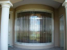 clear corrugated panels on large curved window hurricane