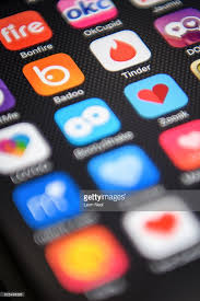 Serial Killer Conviction Prompts Police To Warn Of Dating App     Getty Images The      Tinder      app logo is seen amongst other dating apps on a mobile phone