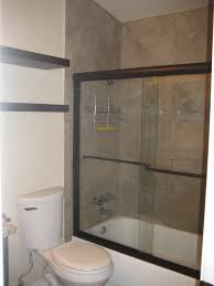 Bathroom Storage Shelves Over Toilet by Tub Shower Combo With Sliding Glass Door By Black Floating Over