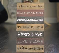 in this house we believe black lives matter wooden equality