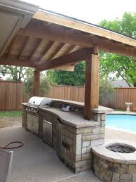 21 best outdoor kitchen design ideas blue pool wooden fences