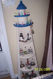 Decorative Lighthouses For In Home Use A Lighthouse Shelf That I Dearly Love Holds A Lot Of Lighthouses
