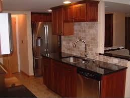 Kitchen Backsplash Cherry Cabinets by Unique Kitchen Backsplash Cherry Cabinets Black Counter Shelving