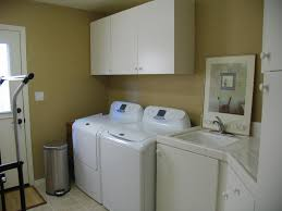 white doors with glass panels modern laundry room with built in bookshelf u0026 undermount sink in