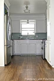kitchen cabinets kitchens with dark tile floors and white