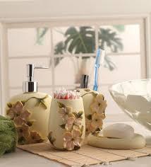 White Bathroom Accessories Set by Buy Shresmo White Polyresin Flora 4 Piece Bathroom Accessory Set