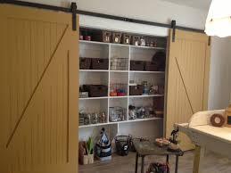 brown wood sliding door custom garage storage cabinet design