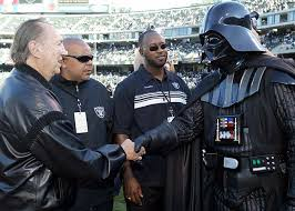 Raiders owners Al Davis shakes hands with Buffalo owner Ralph Wilson before the game.