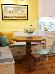 in this kitchen adjacent breakfast nook a small oak table is