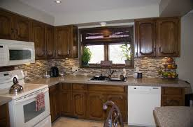Stain Unfinished Kitchen Cabinets by Stain Unfinished Cabinets White Cabinet Ideas With Mosaic Tiles