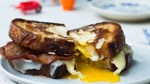 egg in a hole sandwich with bacon and cheddar recipe bon appetit