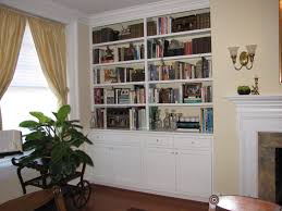 simple red painted floating book shelves on soft wall color