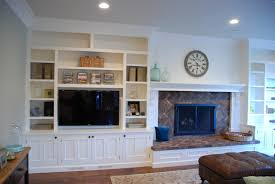 built in stereo and tv cabinet next to fireplace kitchen