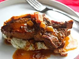 cider braised country style pork ribs with creamy mashed potatoes