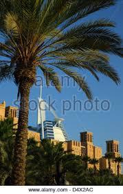 The Burj Al Arab Hotel With Palm Tree Lined Beach Dubai United     Alamy     Madinat Jumeirah and Burj Al Arab hotel  Dubai  United Arab Emirates   Stock Photo