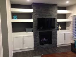my diy stone fireplace with built in cabinets and floating shelves
