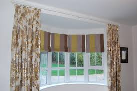 diana murray interiors bow window with roman blinds and dress