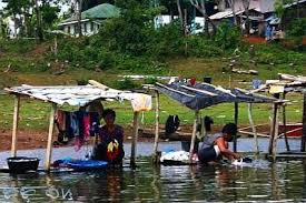 Image of women washing clothes in a river in rural Philippines