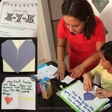Claudine instructs E to fold an origami heart where she pens an original haiku to her bffs  Memoirs of a Budget Mum