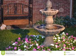 Decorative Home by Decorative Home Water Fountain In A Bed Of Flowers Stock Photo