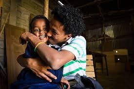 Famous Quotes About Poverty An Ethiopian man hugs and squeezes and young boy   quot