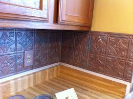 almost done with kitchen backsplash these are plastic faux tin