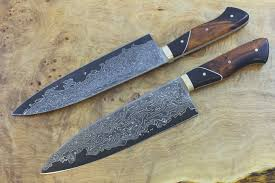 just finished the first kitchen knife made with our new damascus
