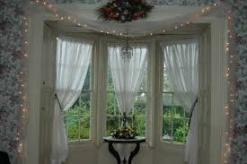 sweet bay windows design with white curtains and classy rounded