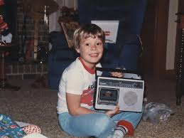 RADIO DAYS   A young Ryan Seacrest posing with his Christmas present and first love