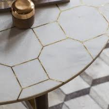 white marble and brass inlay coffee table