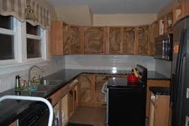 painting kitchen cabinets diy project aholic day paint primer backside doors cabinet frames kitchen