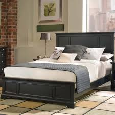 black wooden bed frame with high head board combined with four black wooden bed frame with high head board combined with four short legs and white bedding sheet as well as and